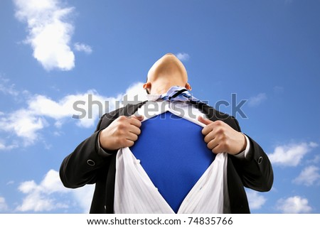 Businessman pulling  his t-shirt open