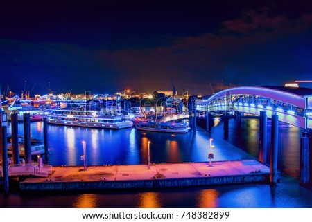 Panorama of the blue Harbour of Hamburg Germany at night   #748382899