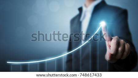 Business development to success and growing growth concept, Businessman pointing arrow graph corporate future growth plan Royalty-Free Stock Photo #748617433