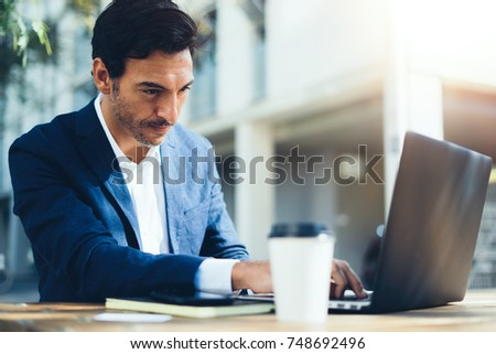 Man working with laptop outdoor #748692496
