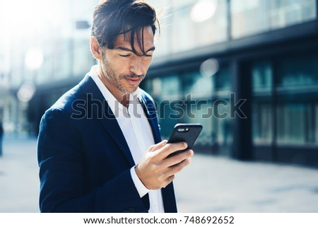 Man with smartphone outdoor #748692652
