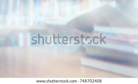 Blurred image, Reading book in library room and bookshelf background, education back to school concept