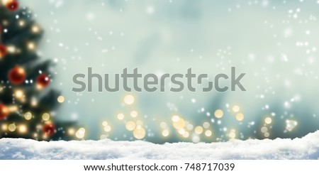 winter background with blurred xmas tree and bokeh lights