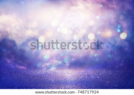 Purple glitter lights background. defocused #748717924