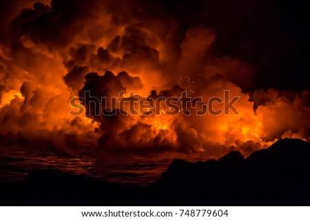 Active lava flow and explosion from the volcano on the Big Island of Hawaii during sunrise #748779604
