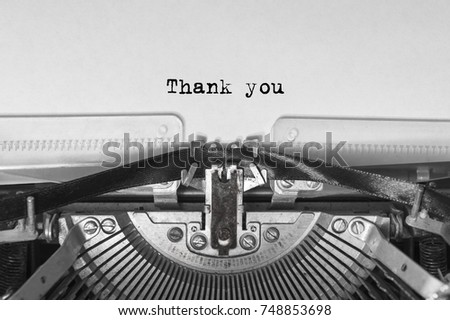 Vintage old typewriter on white background with text thank you. Close up. #748853698