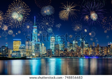 Colorful Fireworks above New York City Cityscape Celebrating New Years Eve #748856683