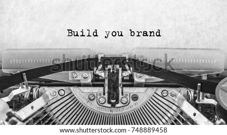 Build you brand words typed on a vintage typewriter in black and white. #748889458