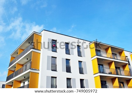 Modern apartment buildings on a sunny day with a blue sky. Facade of a modern apartment building #749005972