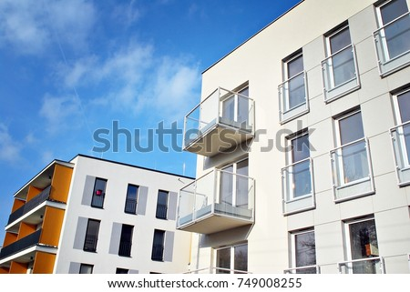 Modern apartment buildings on a sunny day with a blue sky. Facade of a modern apartment building #749008255