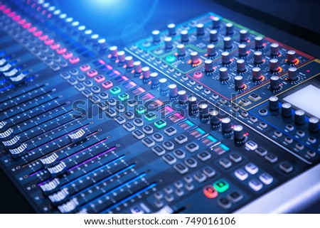 Professional sound and audio mixer control panel with buttons and sliders #749016106