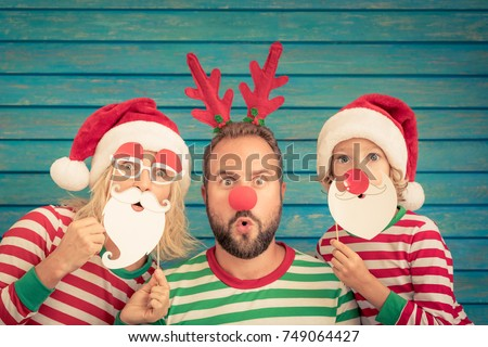 Happy family playing at home. Funny father; mother and child on Christmas eve. Xmas winter holiday concept
