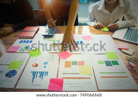 Business People Meeting Design Ideas Concept. Group of Investor diverse brainstorm and pointing at laptop computer on wooden desk. #749066668