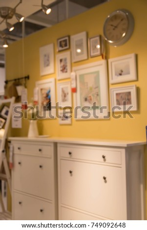 blur picture background  of wooden chest of drawer in furniture mall