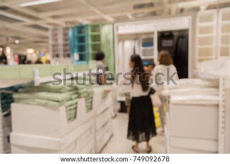 blur picture background  of wooden chest of drawer  or wardrobe in furniture mall