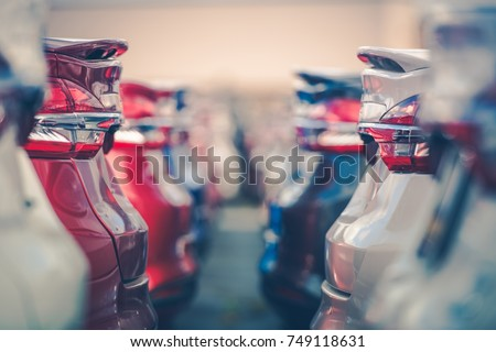 Cars For Sale. Automotive Industry. Cars Dealership Parking Lot. Rows of Brand New Vehicles Awaiting New Owners. Royalty-Free Stock Photo #749118631