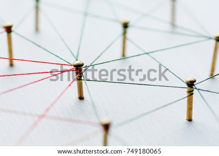 Background. Abstract concept idea of network, social media, internet, teamwork, communication. Thumbtacks linked together by red thread. Isolated. Entities connected. #749180065