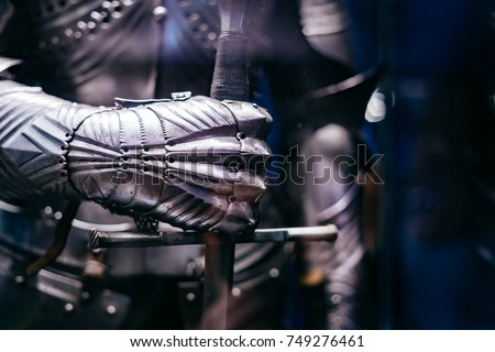 Close up of a Medieval steel armour with hand holding a giant sword Royalty-Free Stock Photo #749276461