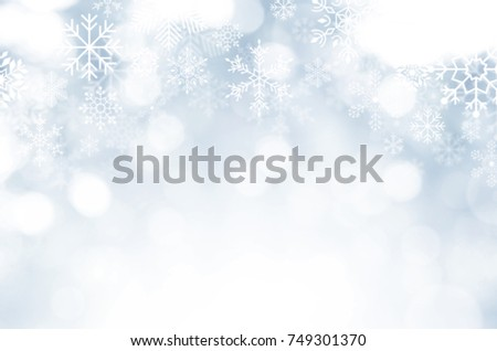Christmas and New year theme background. Light blue blurred abstract background with snowflake.