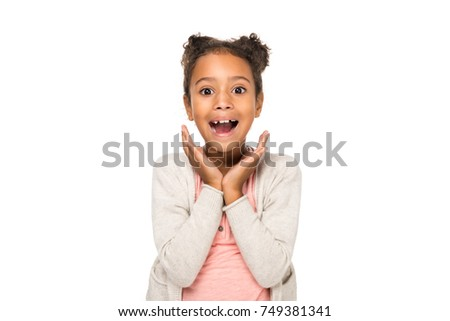 beautiful surprised african american child smiling at camera isolated on white #749381341