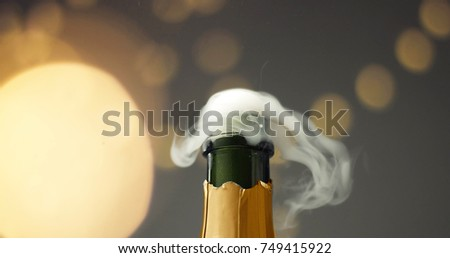 Close up slowmotion of man's hands opening a bottle of champagne on gray background with lights and flares #749415922