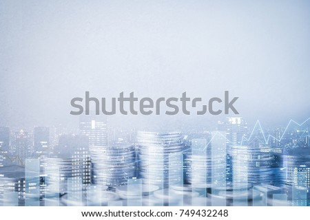 Double exposure of city, graph, rows of coins and blank space for finance and business concept Royalty-Free Stock Photo #749432248