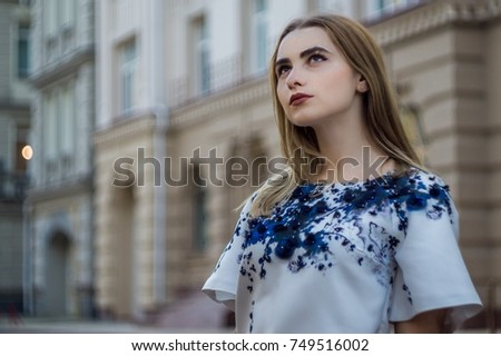 Sexy girl walk around the city. Urban background. #749516002