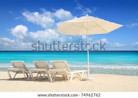 Caribbean beach parasol white umbrella and hammocks turquoise sea #74962762