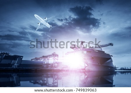 Container Cargo freight ship with working crane bridge in shipyard at twilight for Logistic Import Export background #749839063