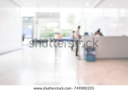 Bank office blur background business customer or patient counter service, cashier desk in lobby inside blurry hospital, office building or hotel waiting area in reception hall #749880205