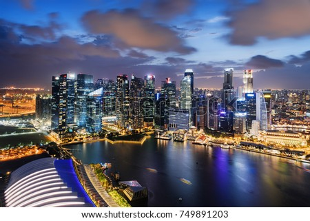 Wonderful night view of skyscrapers at downtown of Singapore. Colorful city lights reflected in water of Marina Bay. Beautiful cityscape. Singapore is a popular tourist destination of Asia. #749891203