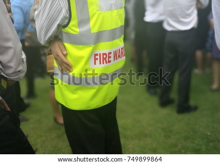 Fire warden man in the training of emergency fire drill