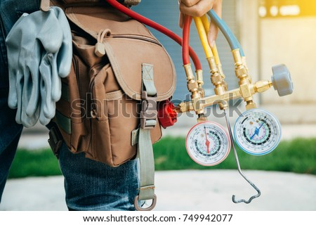 Air Conditioning Technician and A part of preparing to install new air conditioner. Royalty-Free Stock Photo #749942077