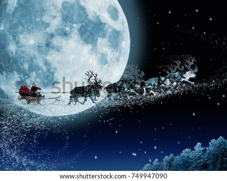 Santa Claus get a move to ride on their reindeer. Magic Santa's sleigh flying over Christmas fairy forest on the background of huge moon. #749947090