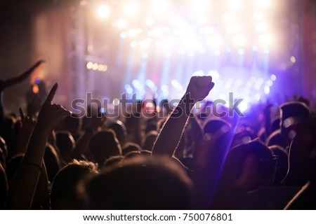 Cheering crowd with hands in air at music festival #750076801
