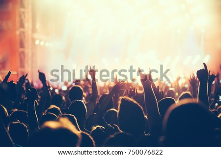 Cheering crowd with hands in air at music festival #750076822
