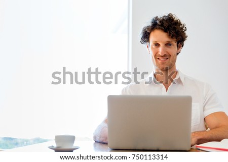 Man working on laptop at home #750113314