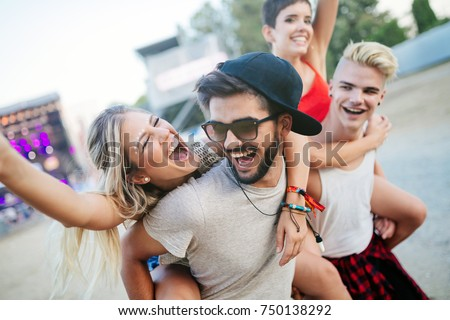 Group of friends having fun time at music festival #750138292