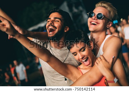 Group of friends having great time on music festival Royalty-Free Stock Photo #750142114