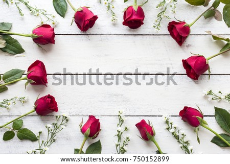Red roses on wooden board background with copy space #750152899