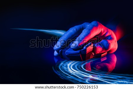 Professional wireless Game Mouse on dark background with techno light as line of mouse movment