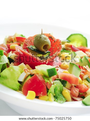 Healthy eating. Vegetable seasonal salad in white plate closeup. #75025750