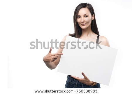 The beautiful mixed asian-caucasian race girl  holds in hand the empty white plate isolated on a white background. Natural make-up. Copy space. Healthy clear skin. #750338983