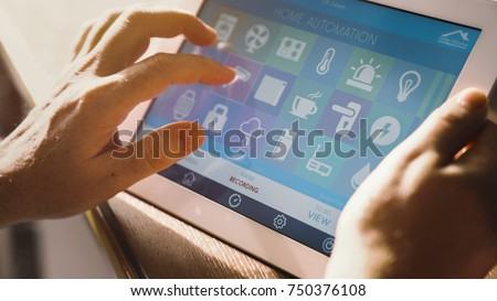 smart house device smartphone with app icons on tablet pc #750376108