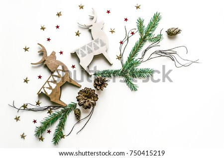 Christmas composition with deer, stars and fir branches. New Year background for presentation of work or text. Beautiful greeting card. Copy space.Top view Royalty-Free Stock Photo #750415219