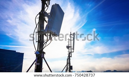 Silhouette of 5G smart cellular network antenna base station on the telecommunication mast  Royalty-Free Stock Photo #750428737