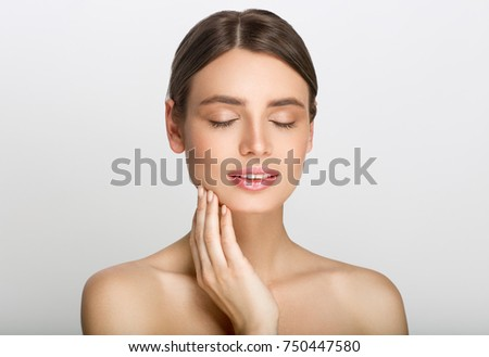 Beauty woman with healthy skin portrait isolated on gray background. Studio shot. #750447580