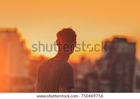 Defocused cityscape background. Gorgeous bokeh. Man on the sunset background. #750469756