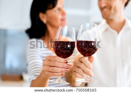 Portrait of a couple having a glass of red wine #750508165