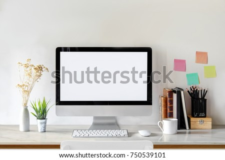 Workplace mockup concept. Mock up modern home decor desktop computer with vintage books, houseplant. Artist workspace with copy space for products display montage.Mockup desktop. #750539101
